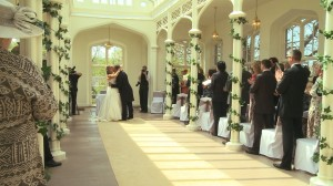 summer wedding at St Audries park in somerset in the orangery being filmed