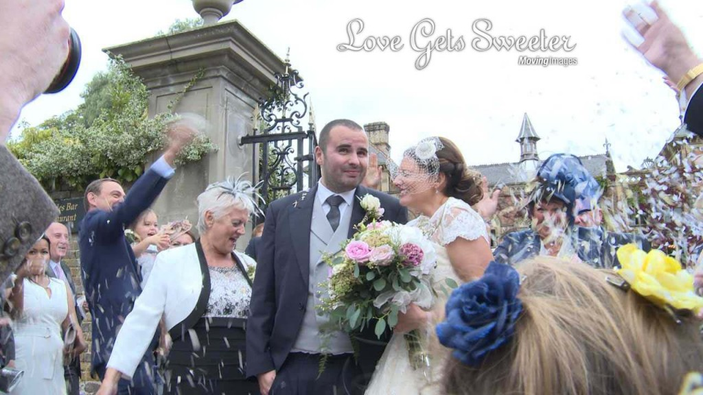 soughton hall bride and groom covered in confetti