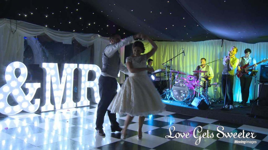 first dance at Soughton Hall in front of Mr and Mrs light up letters