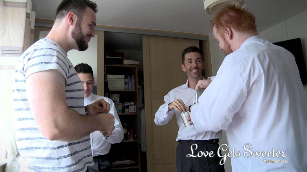 groom and groomsman drinking whisky morning of cheshire wedding