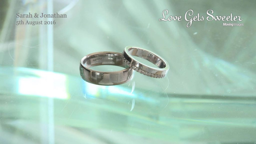 wedding rings on glass table for video liverpool