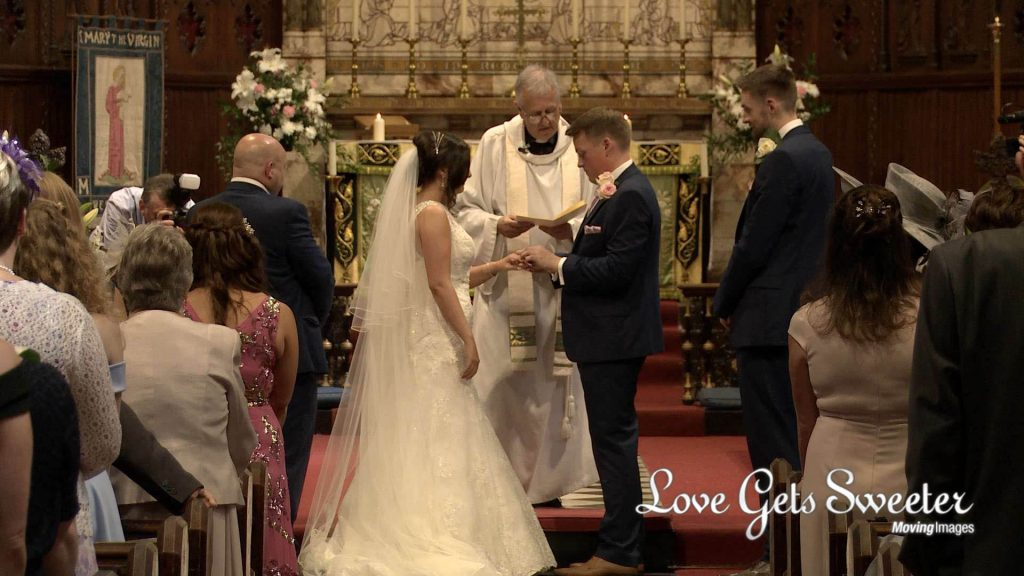 exchanging wedding rings at ceremony st marys west derby