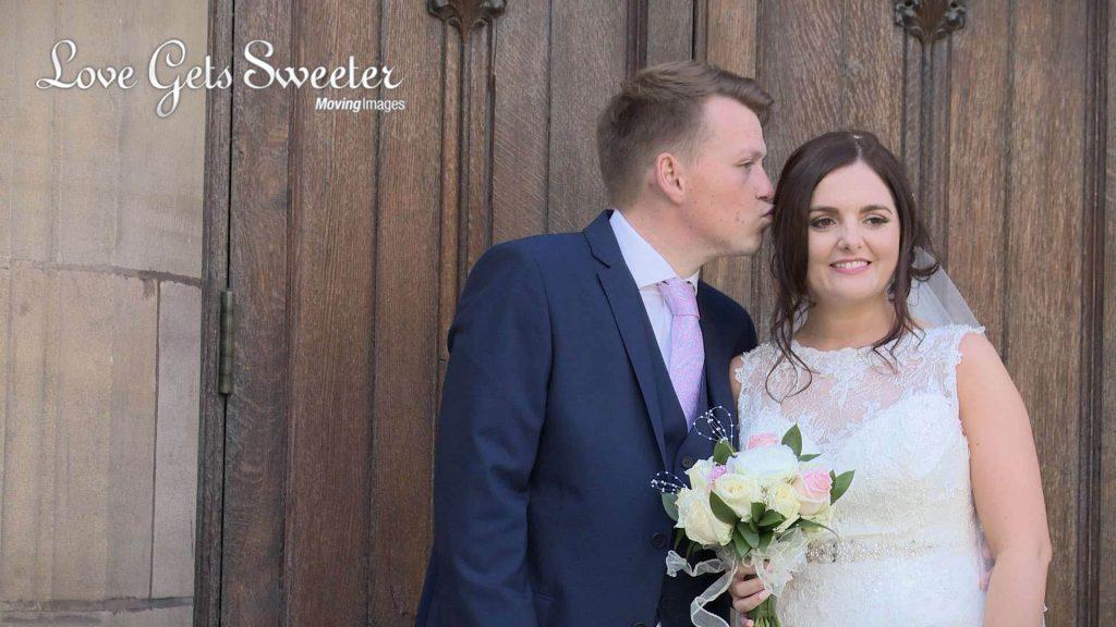 groom kissing bride outside st nicholas church liverpool