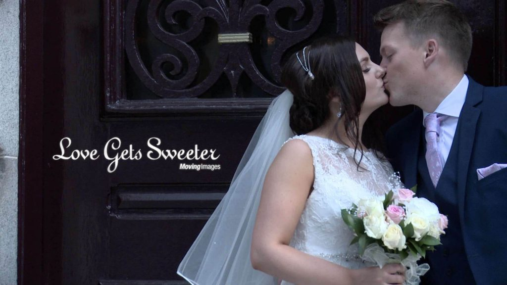bride and groom kiss outside doors at The racquet club liverpool