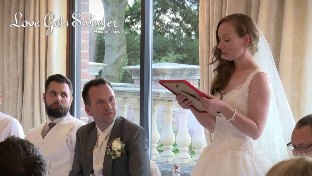 bride surprising her groom with a speech and special Manchester United signed wedding gift