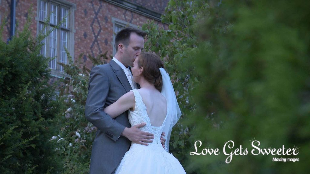 relaxed and romantic moment between the bride and groom during filming at their wedding
