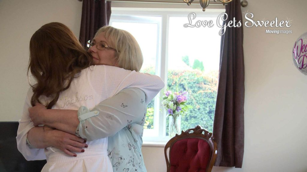 mum and daughter having a big emotional hug morning of the wedding