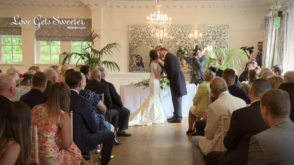 first kiss as husband and wife during weddingceremony at eaves hall videography