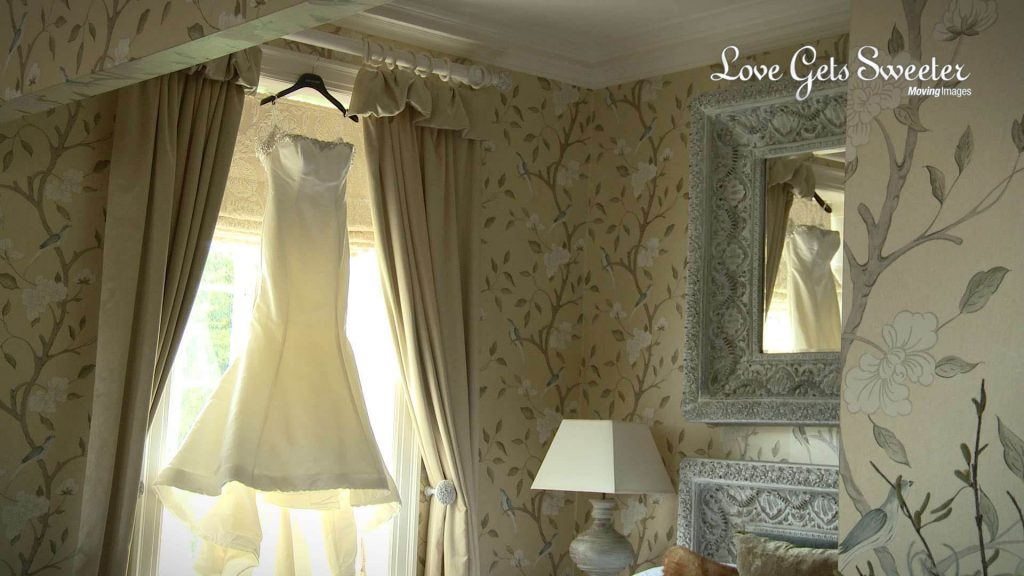 wedding dress hanging up in Eaves Hall wedding suite