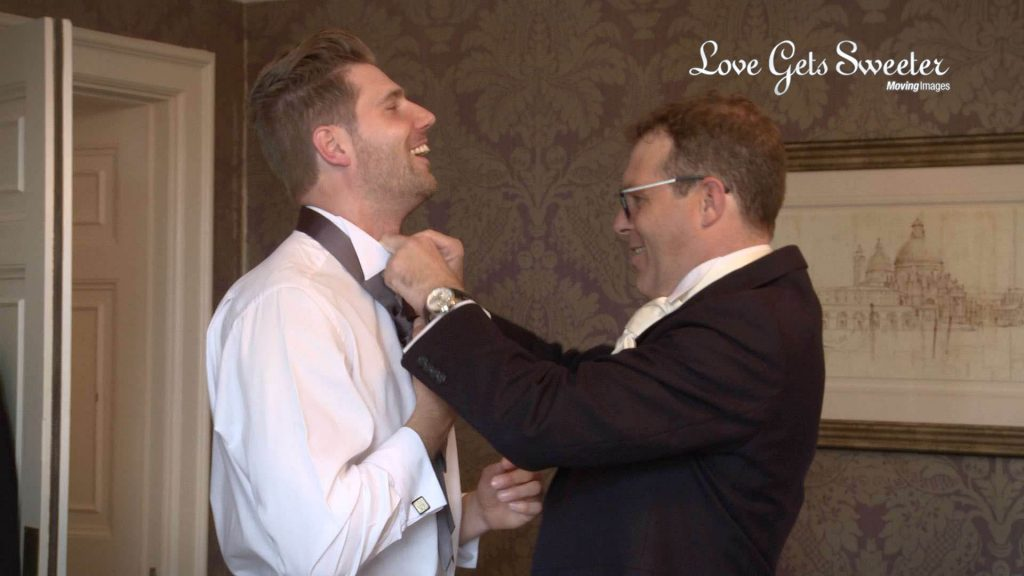 groom helping ushers get ready at Eaves Hall in Clitheroe