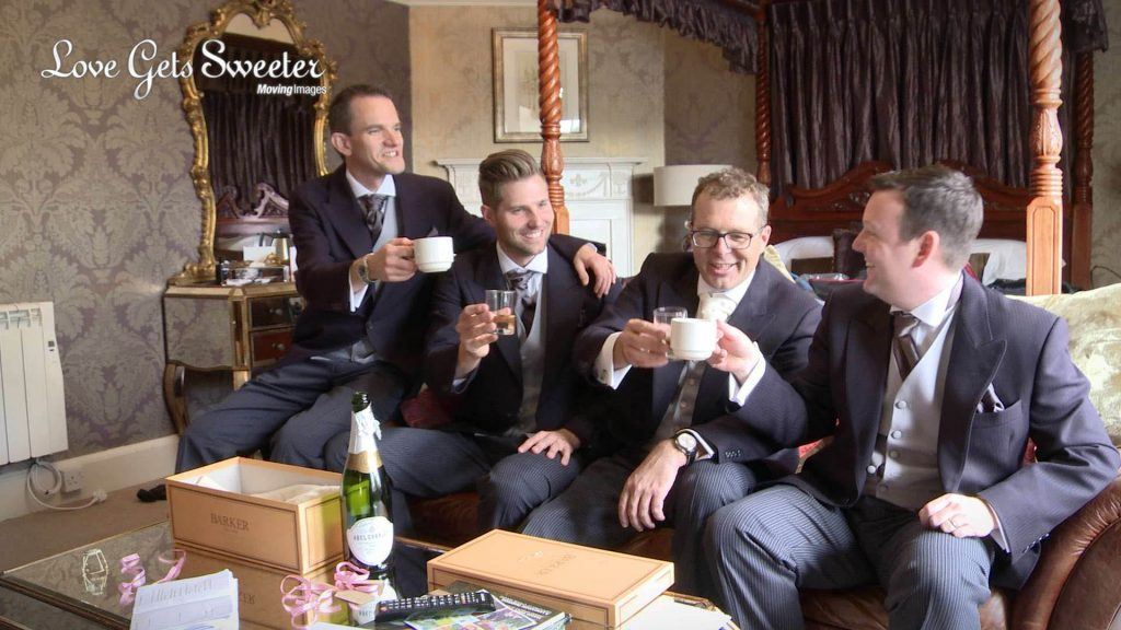 groom and groomsmen drinking champagne out of tea cups at Eaves Hall