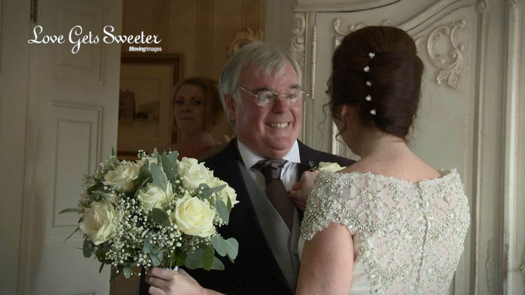 dad seeing daughter dressed as a bride filming at eaves hall