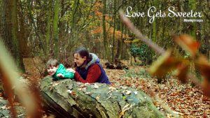 mum and toddler playing in the woods laughing in front of the video in Tarleton Lancashire