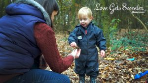 mum and 2 year old son learning about acorns for a very natural documentary style video of their family day out in lancashire