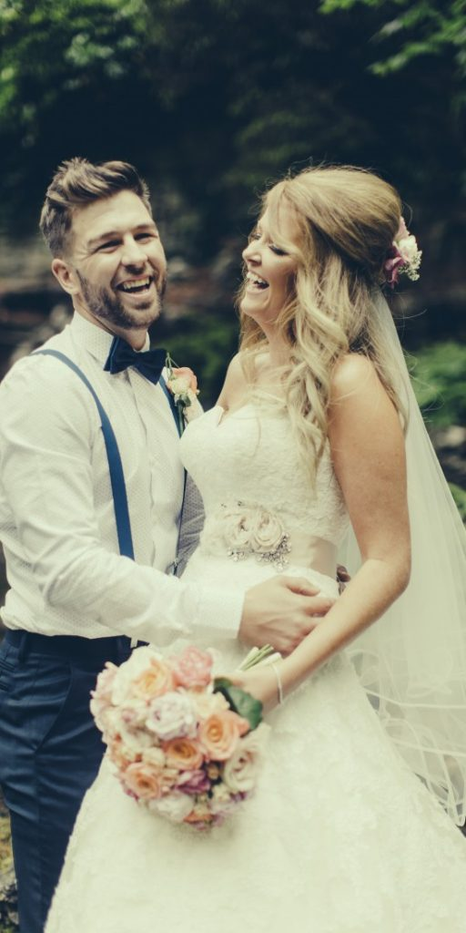 laughing bride and groom photographed by Lottie Designs in Lancashire