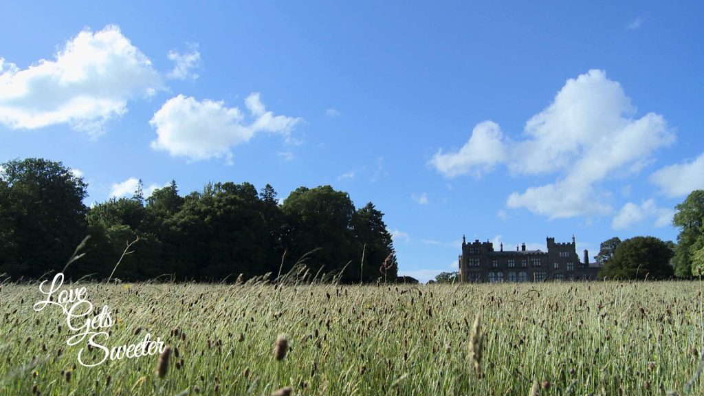 Love Gets Sweeter videography film the bright blue sky and sunshine during a wedding. Showing Armathwaite hall hotel to be the perfect luxury country wedding venue in the lake district in Cumbria